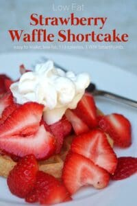 Strawberry Waffle Shortcake with fresh sliced strawberries on a toasted waffle garnished with whipped cream.