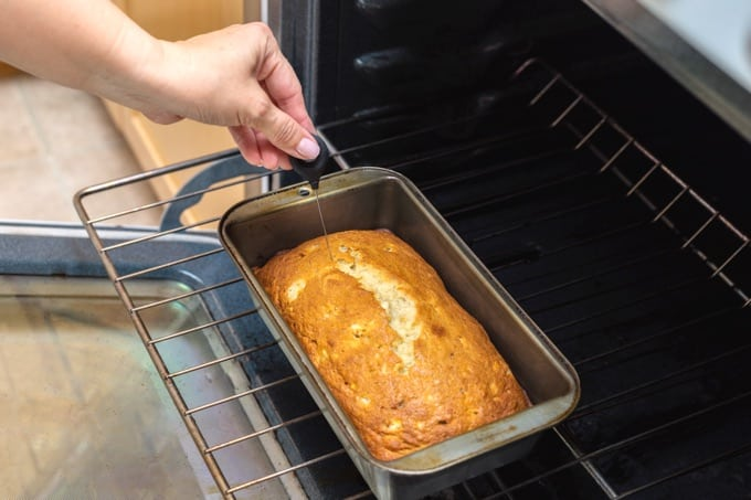 Testing banana bread for doneness