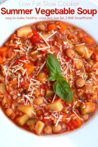 Summer Vegetable Minestrone Soup topped with fresh basil and grated Parmesan cheese in white bowl.