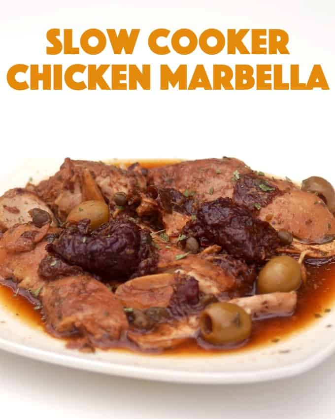 Slow cooker chicken marbella with olives, prunes and capers on white dinner plate.