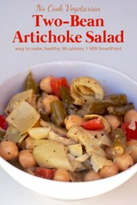 Two Bean Artichoke Salad in white bowl.