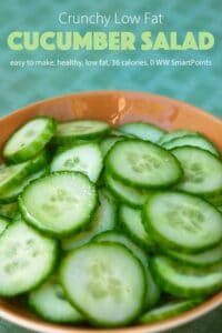 Simple cucumber salad in brown bowl on table.