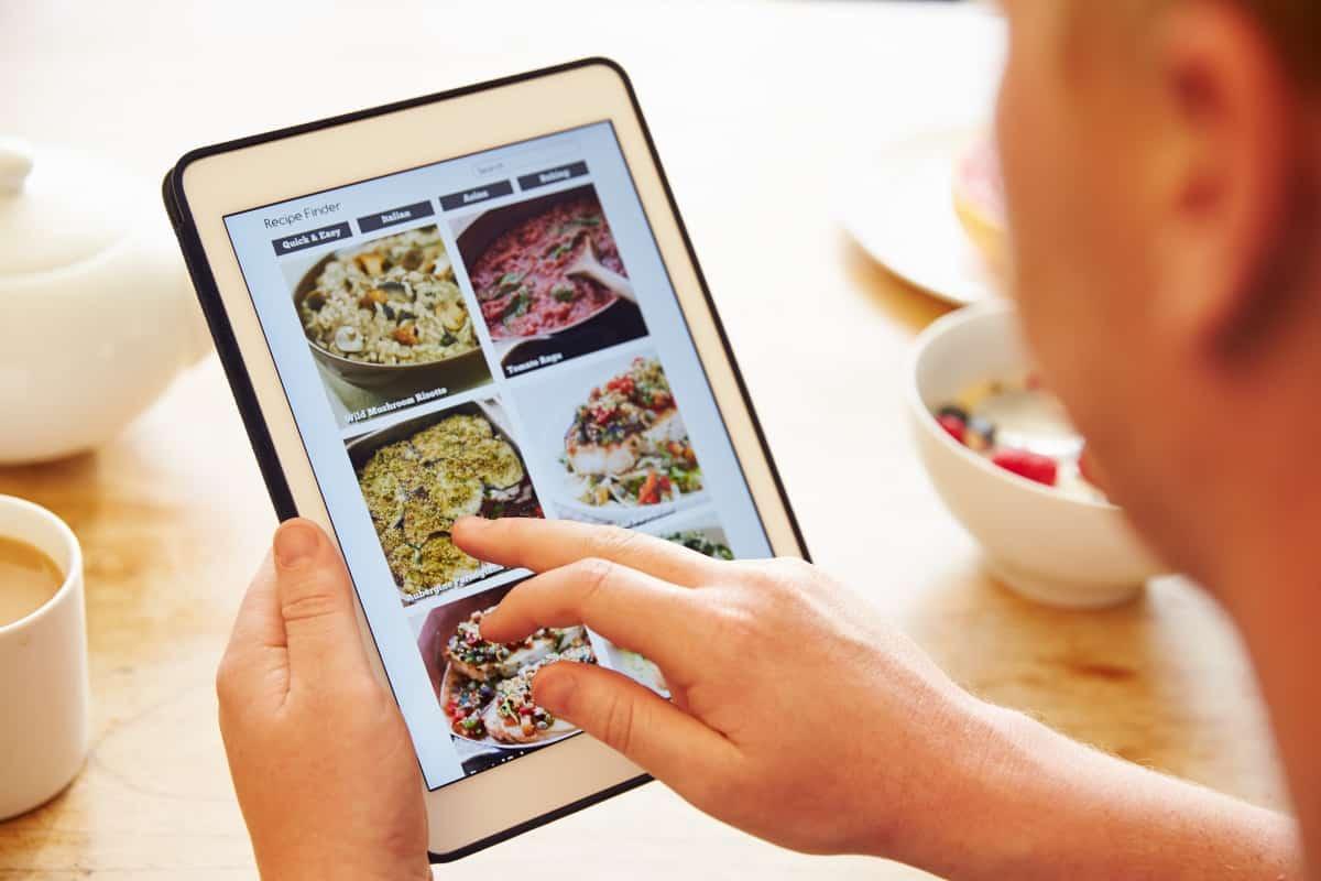 Using recipe app on digital tablet.