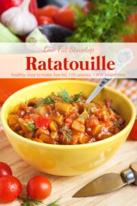 Ratatouille with fresh herbs in yellow bowl with spoon.