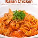 Spaghetti marinara with chicken in white bowl.
