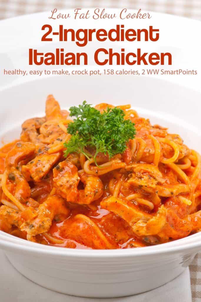 Spaghetti marinara with chicken in white bowl.