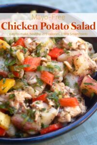 Mayonnaise-free potato salad with chicken in blue bowl.