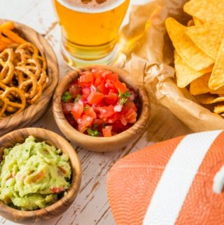Football party food for Super Bowl Day, nachos, salsa, guacamole, pretzels