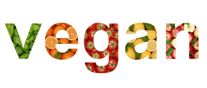 The word vegan written with vegetables and fruits
