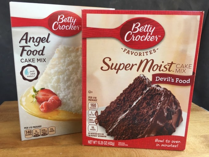 Two Boxes of Betty Crock Cake Mix One Angel Food Cake Side by Side