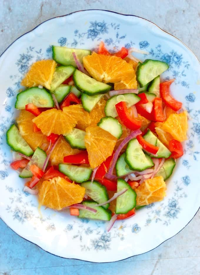 Orange Cucumber Salad in flowered serving bowl