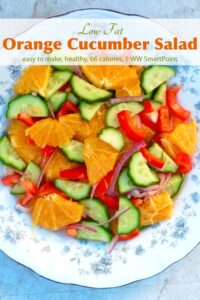 Orange Cucumber Salad with onion and red pepper on a serving platter