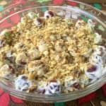 Creamy Grape Salad in Clear Glass Bowl Above Colorful Tablecloth