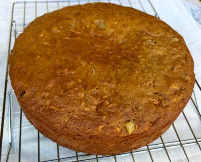 Fresh baked carrot cake cooling on rack