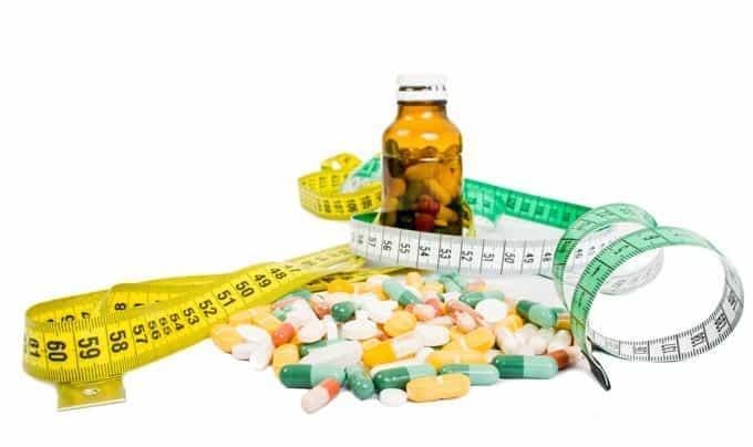Varios pills and tape measure