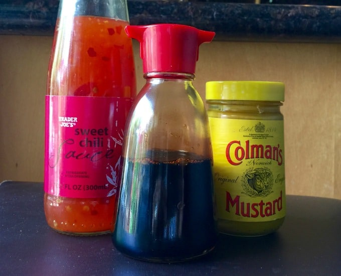 Bottles of sweet chili sauce, soy sauce and spicy hot mustard