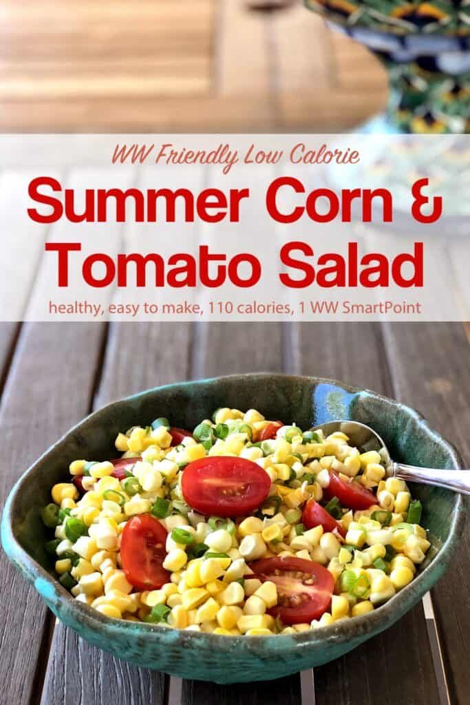 Fresh summer corn and tomato salad and green ceramic bowl on wooden table.