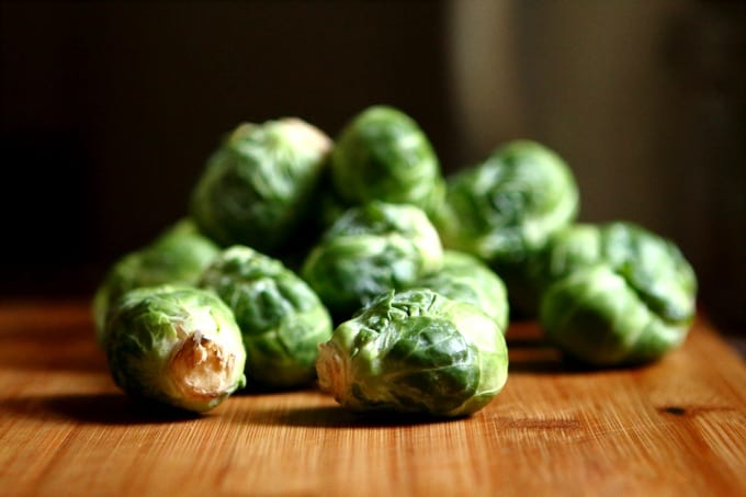 Fresh Brussels sprouts on wood cutting board