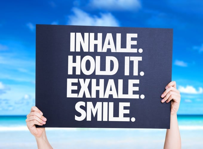 Sign that reads - Inhale. Hold it. Exhale. Smile.