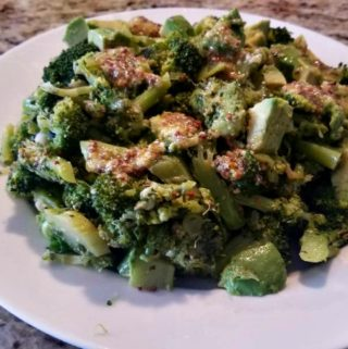 broccoli avocado salad on white plate