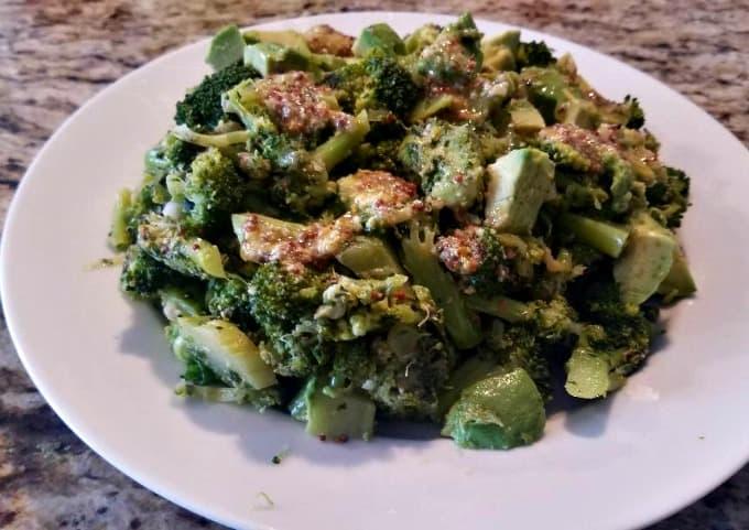 broccoli avocado salad on white plate
