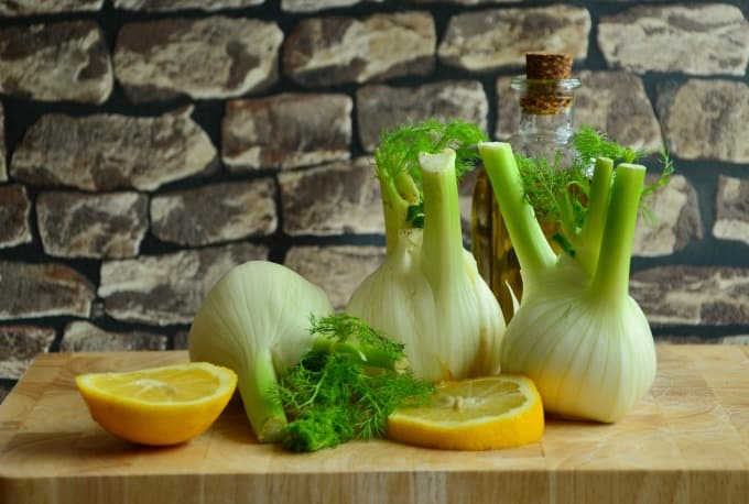 Lemon slices and fennel bulbs on counter