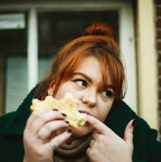woman eating sandwich mindful