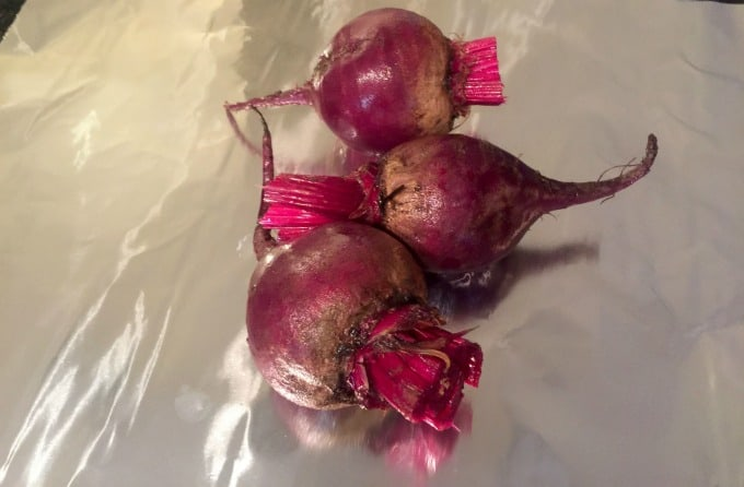 Raw red beets on aluminum foil