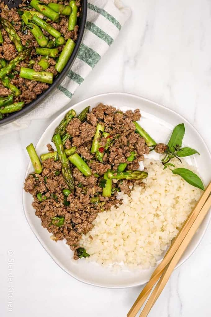Thai Basil Ground Beef with Cauliflower Rice on a white plate with chopsticks