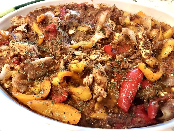 Slow Cooker Italian Chicken with Peppers and Italian Spices in a white bowl