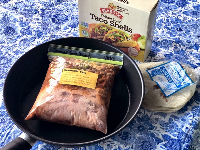 Southwest Taco Freezer Meal Bag with a skillet, tortillas and crunchy taco shells