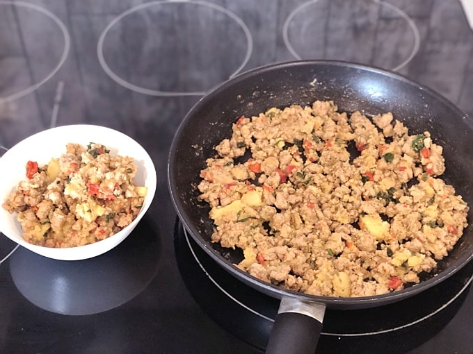 Turkey Breakfast Sausage Scramble in skillet next to a small serving bowl