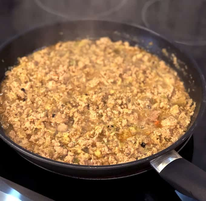 Green Chili Ground Turkey cooking in a skillet on a stove
