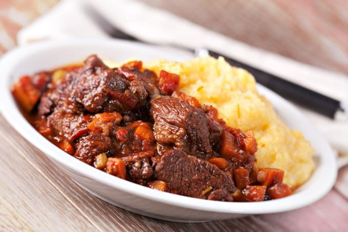 Provencal Beef Stew on a plate with polenta