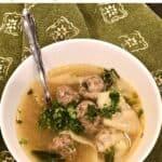 Bowl of Broken Wonton Soup garnished with fresh chopped cilantro