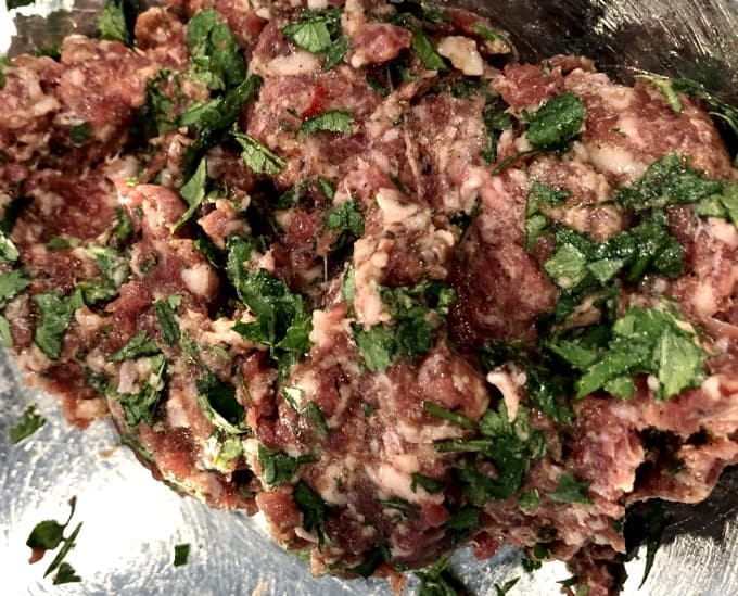 Sausage meat mixed with spices and fresh chopped cilantro