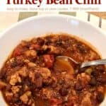 Tex-Mex Turkey and Pinto Bean Chili in a bowl with a spoon
