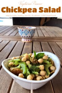 Vegetarian Passover Chickpea Salad in a small white bowl with hand-painted decorative bowl in the background