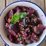 French beet salad with Mediterranean black olives, garlic ginger and mint in serving bowl