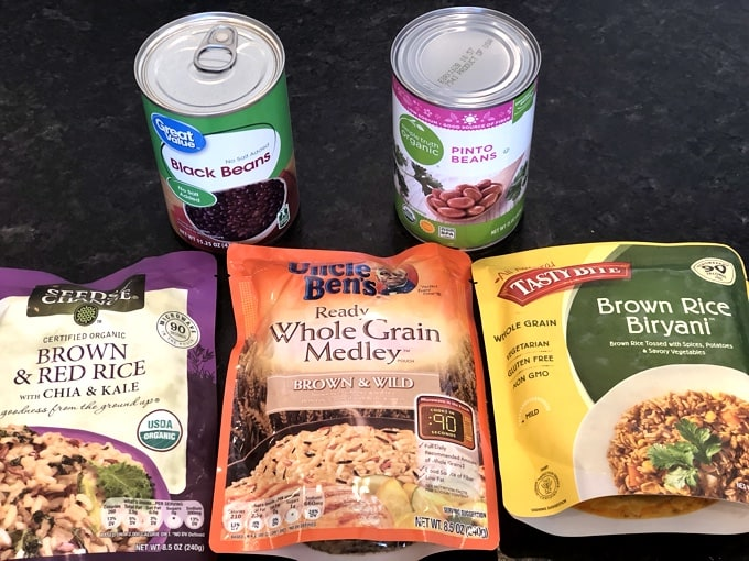 Ingredient variations for black bean cakes including can of pinto beans and packaged rice medleys.