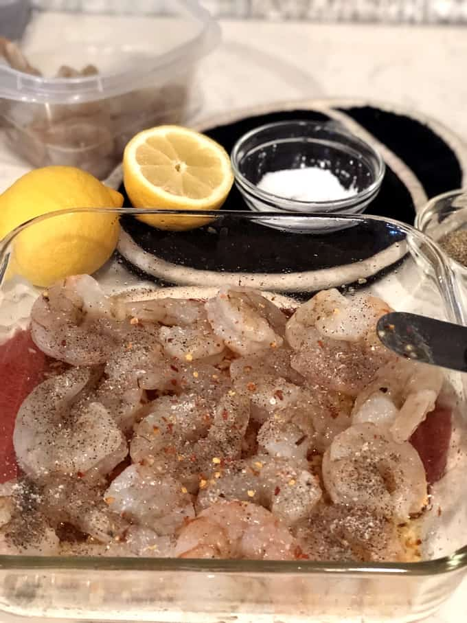 Raw, peeled and deveined shrimp seasoned with salt, pepper and red pepper flakes.