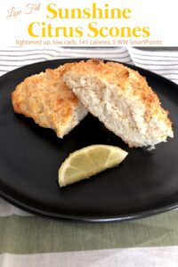 Low-Fat Citrus Scone on black plate with lemon wedge.