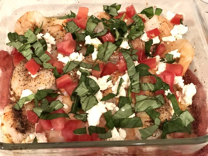 Shrimp seasoning with salt, pepper, and red pepper flakes and topped with chopped tomatoes, crumbled Feta cheese and chopped basil.