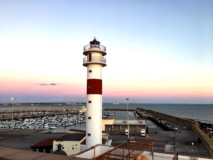 Rota Lighthouse at dusk in Rota, Cadiz, Spain.
