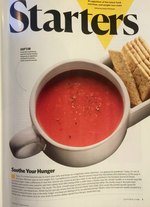 Magazine photo of tomato soup with crackers.