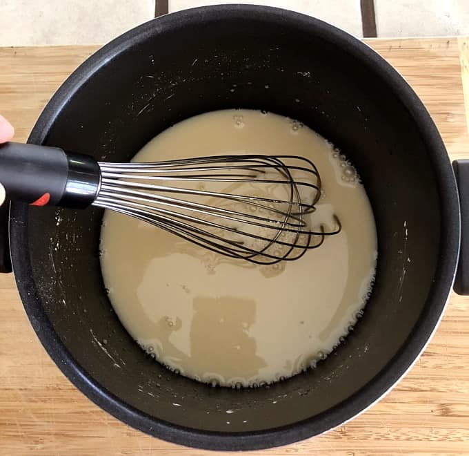 Whisking apple juice, agave nectar, cornstarch and sea salt in saucepan.