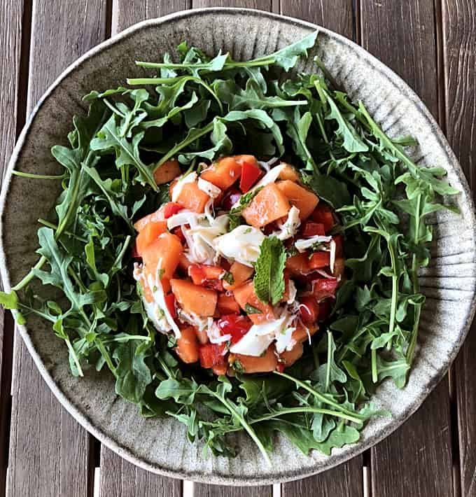 Papaya Crab Salad with Mint Dressing on bed of Arugula