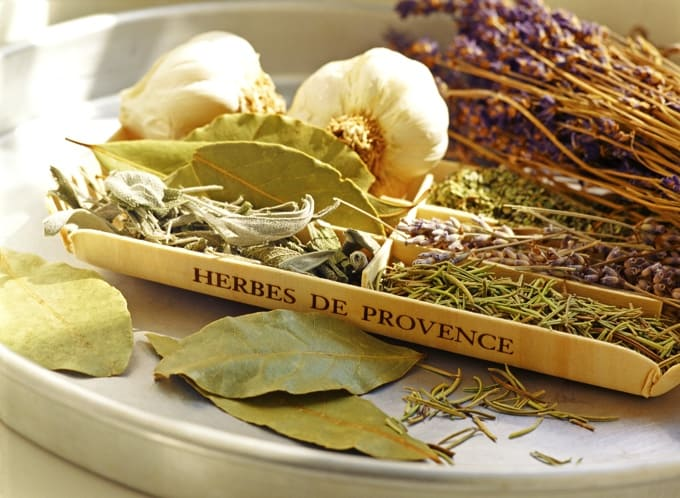 Dried Herbes de Provence spices on metal tray.