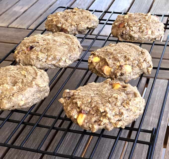 Peach breakfast cookies cooling on wire rack.
