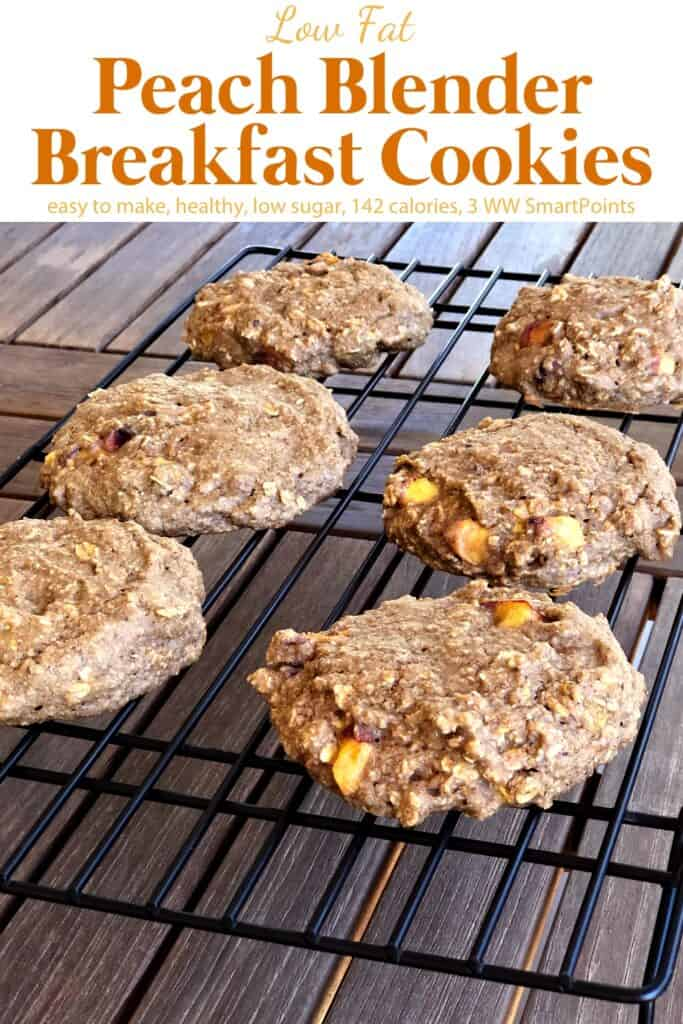 Peach blender breakfast cookies cooling on wire rack on wood table.